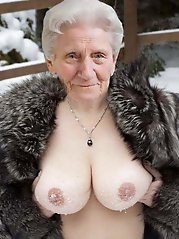 Shapely aged whore showing off her breasts